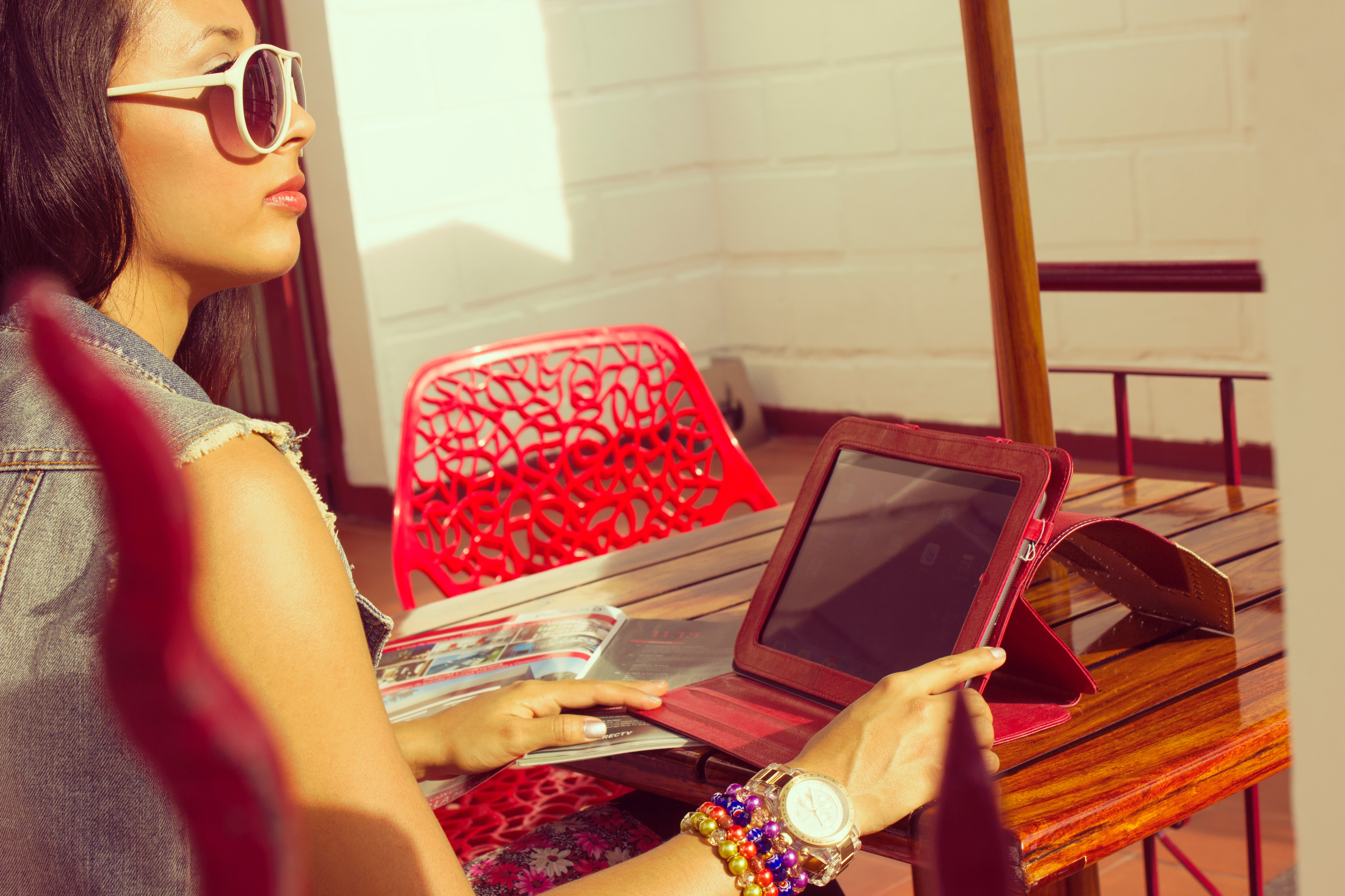 Young woman with red laptop